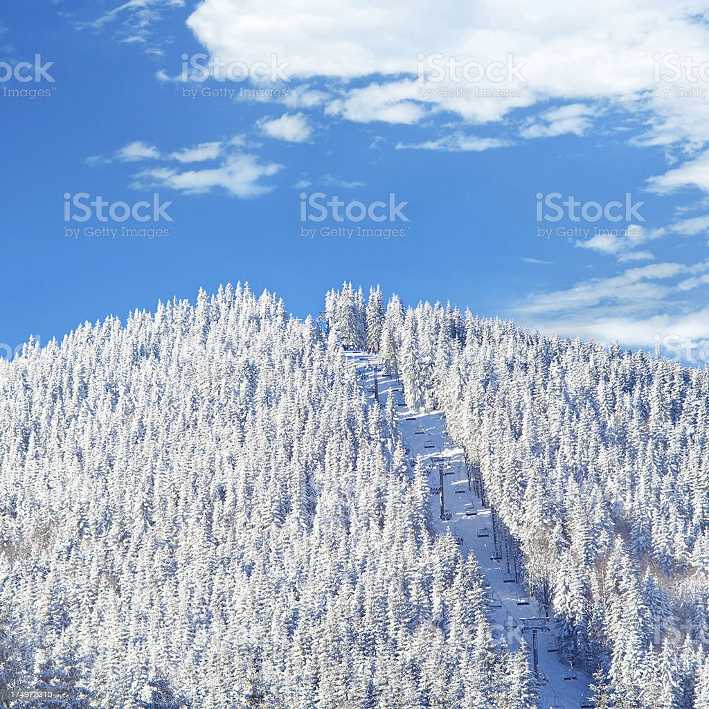Mountain peak with funicular in winter royalty-free stock photo