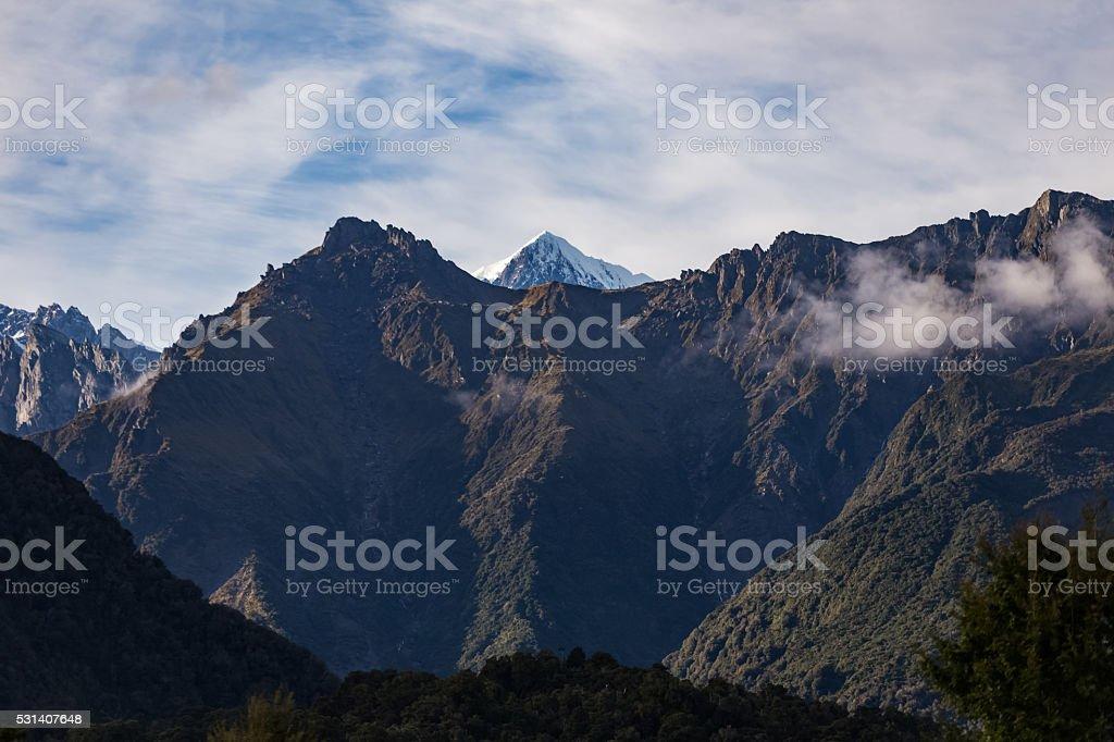 mountain peak with glacier stock photo