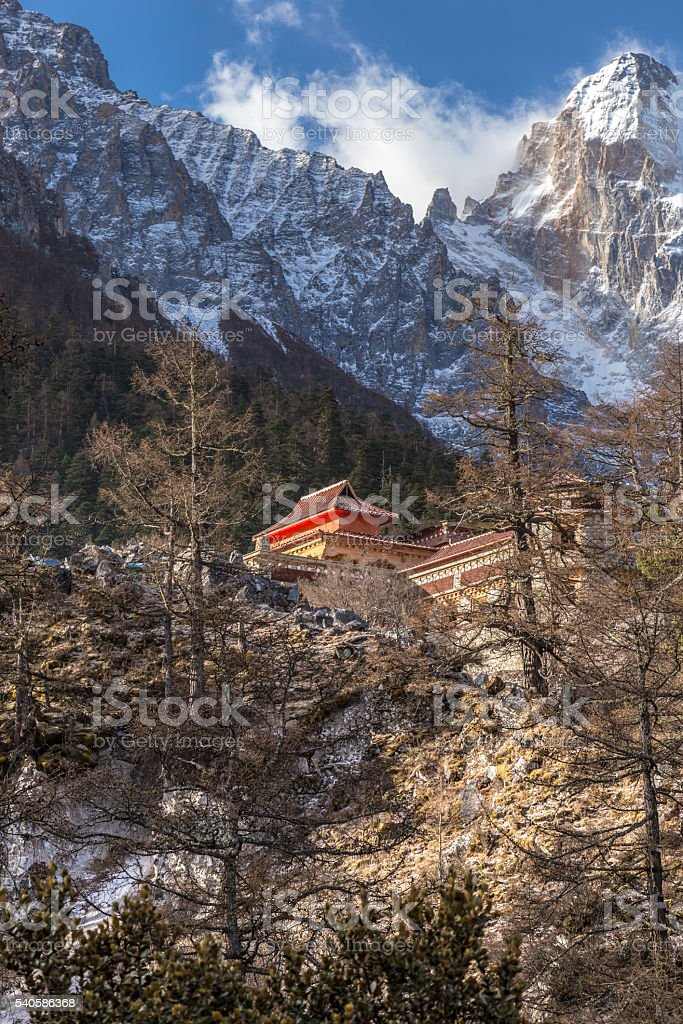 Mountain peak with snow and local temple stock photo