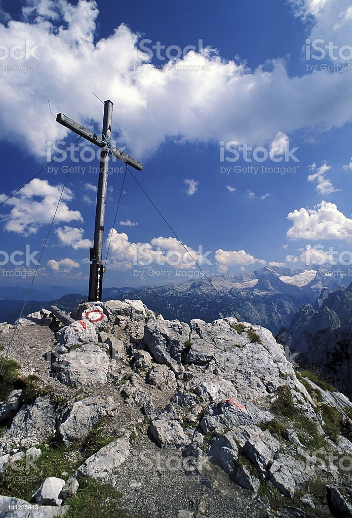mountain peak with wooden cross royalty-free stock photo