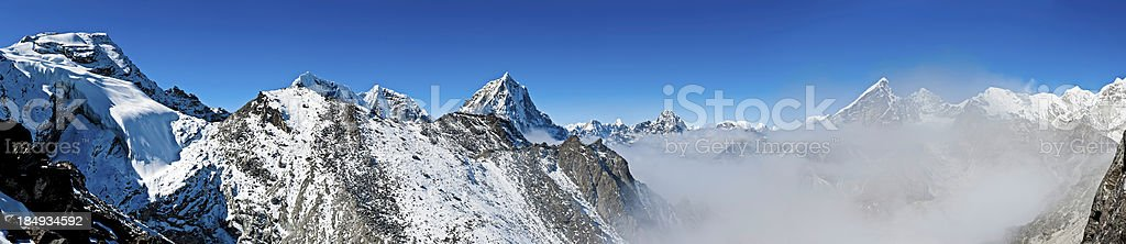 Mountain peaks above the clouds Himalayas Nepal stock photo