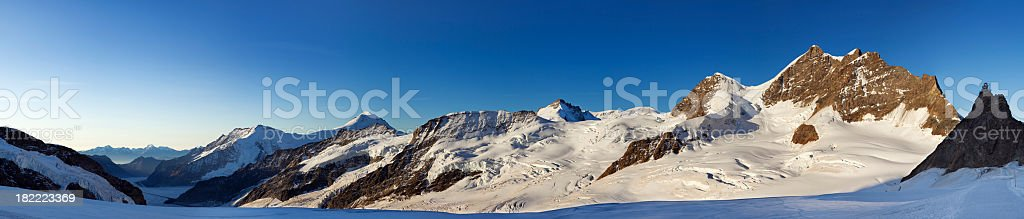 Mountain peaks at sunrise from Jungfraujoch in Switzerland royalty-free stock photo