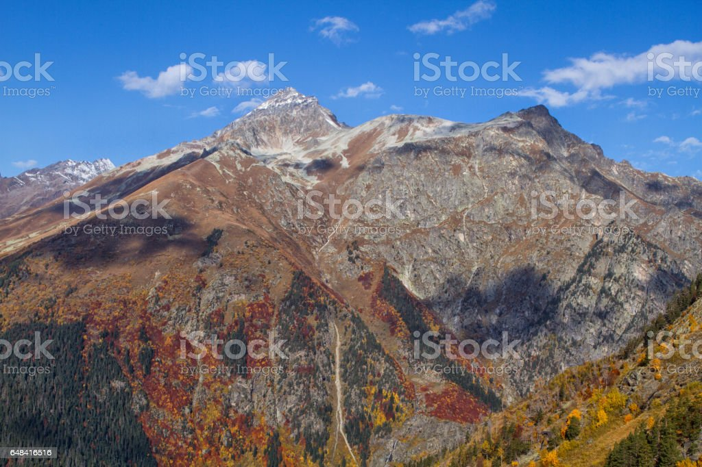 Mountain peaks in clouds stock photo