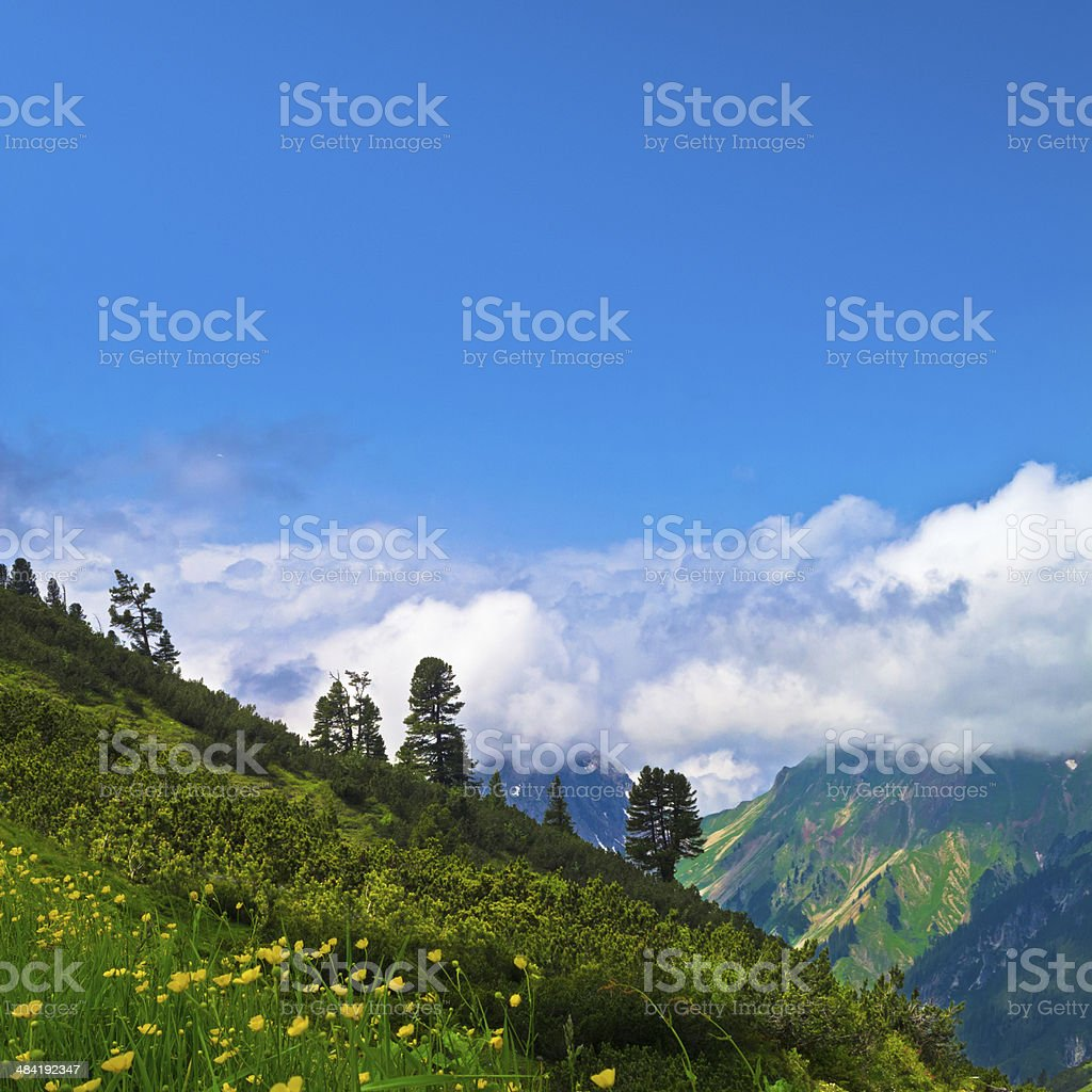 mountain peaks in the clouds royalty-free stock photo