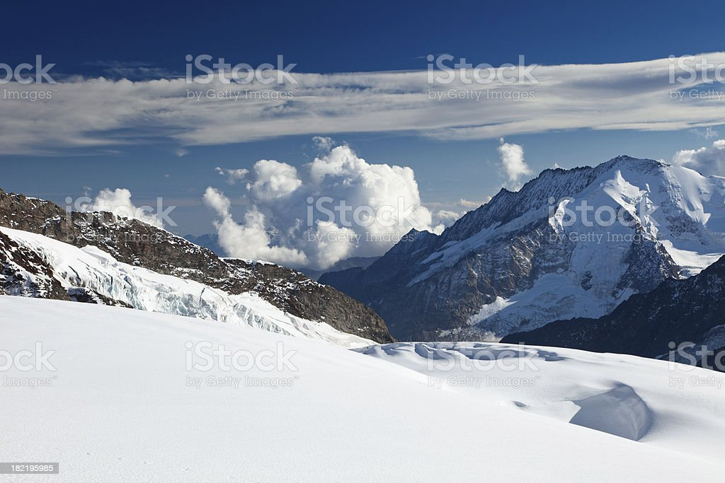 Mountain peaks on a sunny day from Jungfraujoch in Switzerland royalty-free stock photo