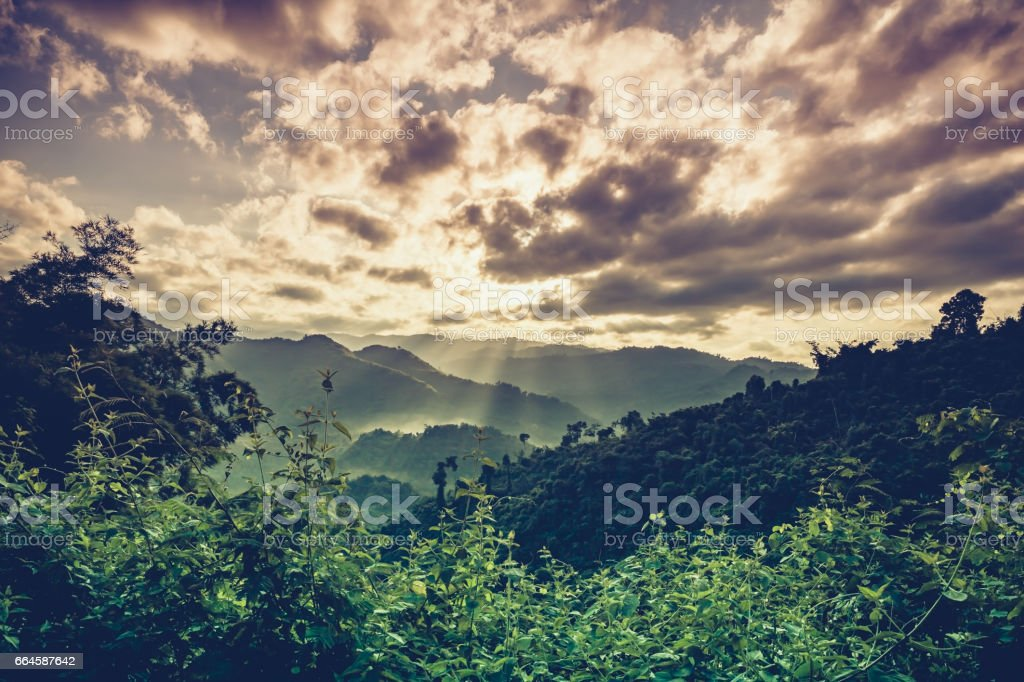 Mountain peaks with sky and beautiful full moon. stock photo