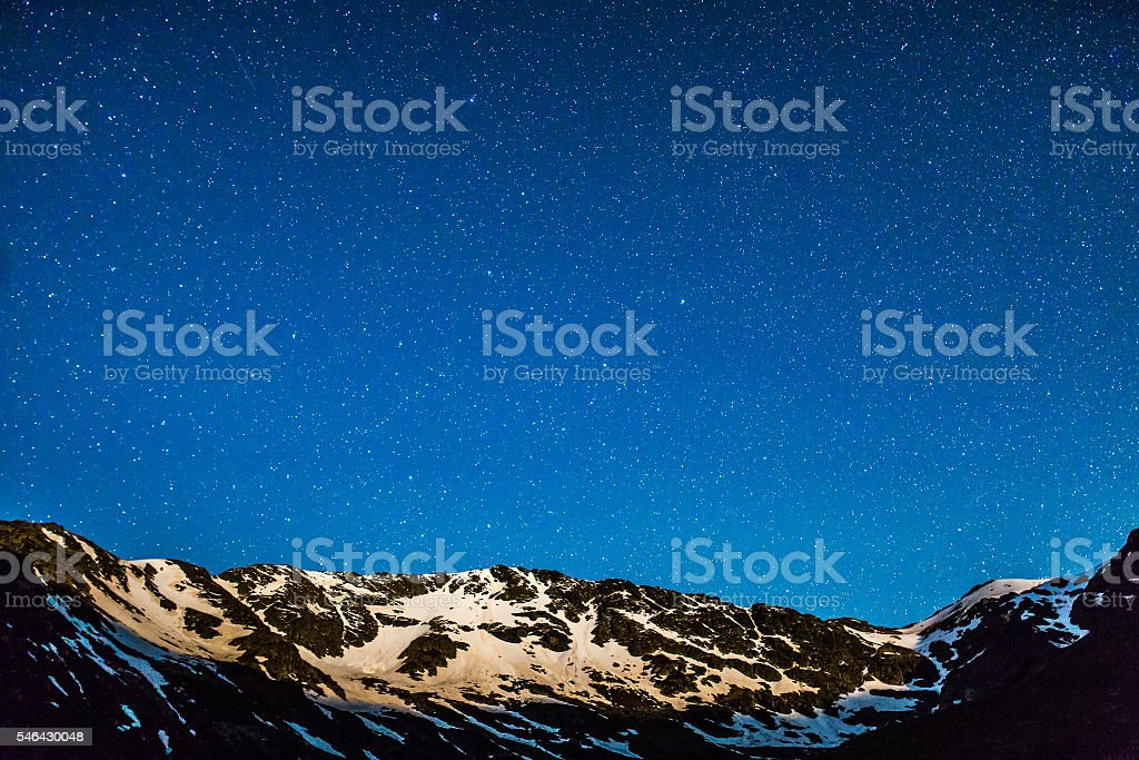 Mountain peaks with stars stock photo