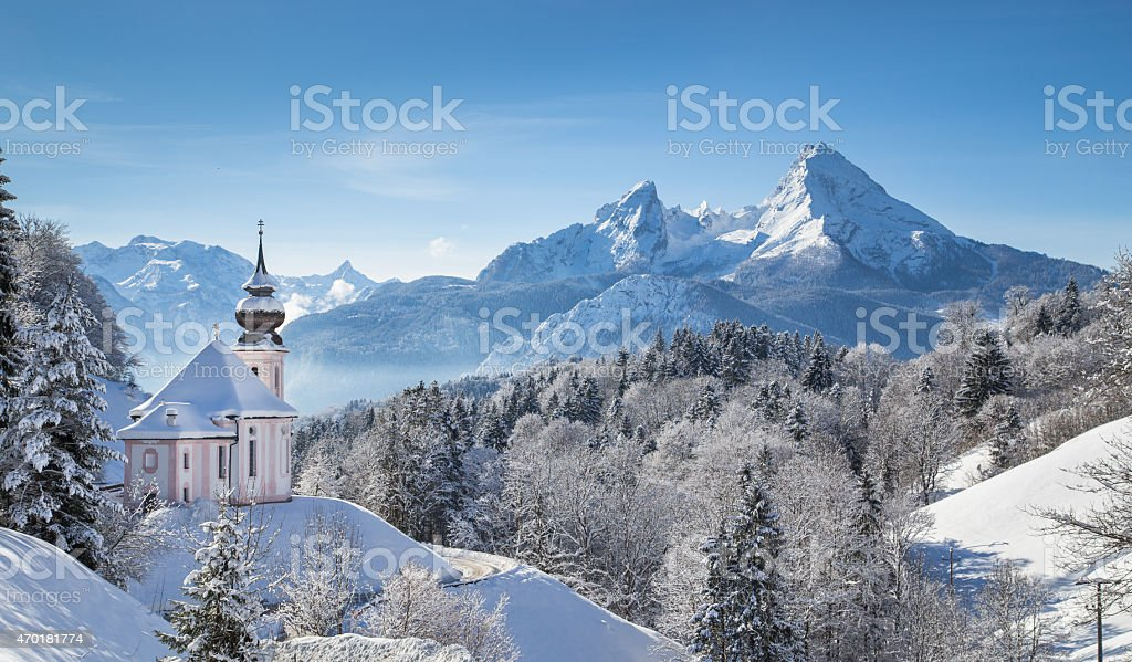 Mountain pilgrimage church in snowy Alpine scene stock photo