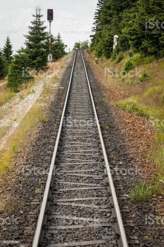 Mountain Railway Line through the forest in mist stock photo