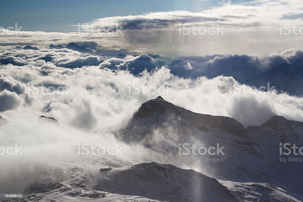 Mountain range above the clouds with sun light royalty-free stock photo
