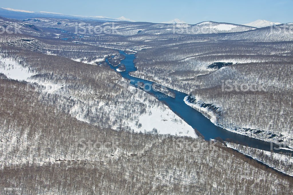 Mountain range after a snowfall and the river stock photo