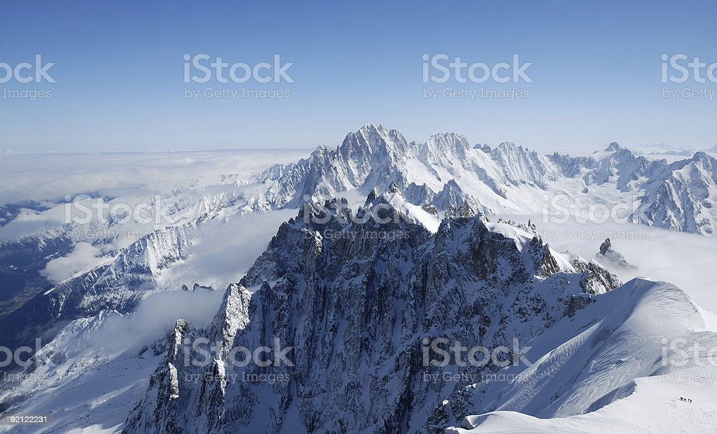 Mountain range among snow and clouds, the Alps royalty-free stock photo