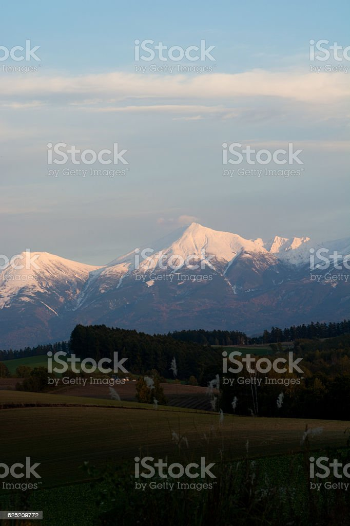 Mountain range of evening glow stock photo