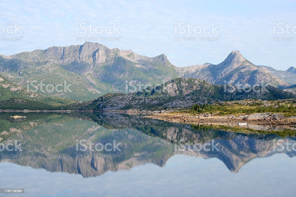 Mountain range reflected in water royalty-free stock photo