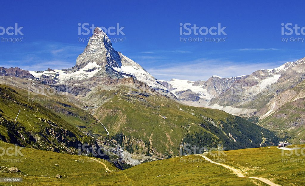 A mountain range with grassy valleys royalty-free stock photo