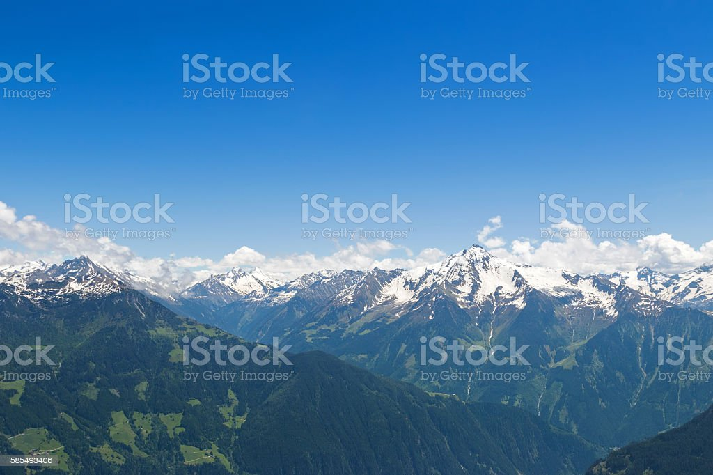 Mountain ranges of the Zillertal with snow and blue sky stock photo