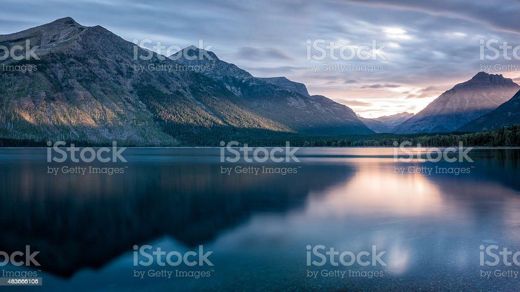 Mountain reflection at sunrise stock photo