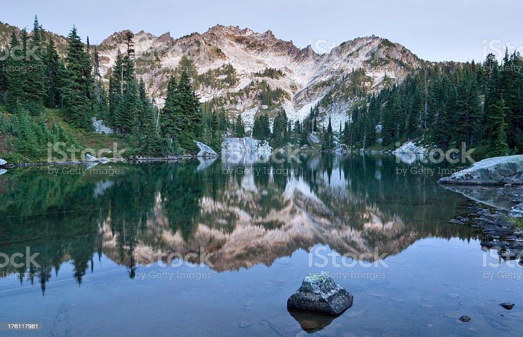 Mountain reflection in alpine lake royalty-free stock photo