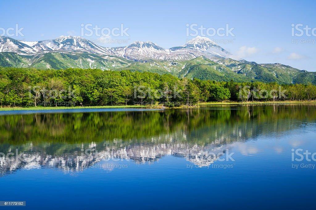 Mountain reflection in Lake Sanko  on Hokkaido, Japan stock photo