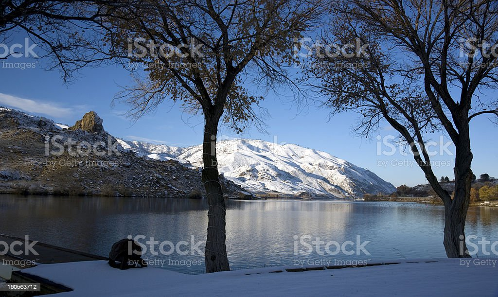 Mountain Reflection Winter Snow on the Peaceful Columbia River stock photo