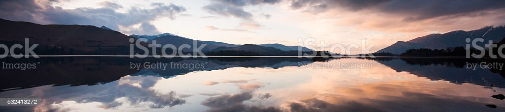 Mountain reflections in Derwent Water stock photo
