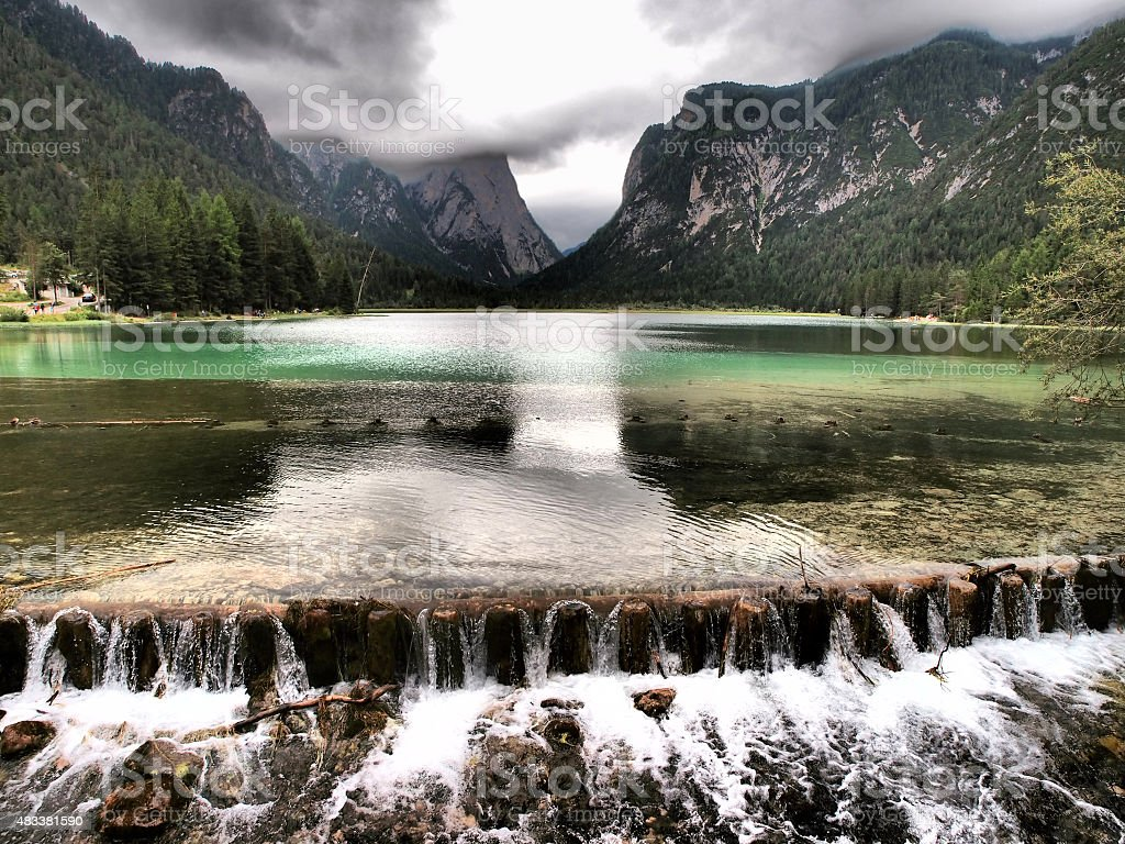 Mountain reflections on water in Toblach Lake stock photo