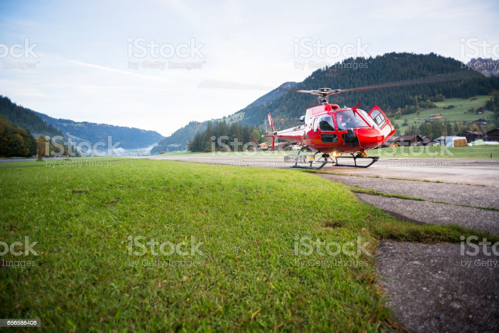 Mountain Rescue Helicopter Prepares for Takeoff stock photo