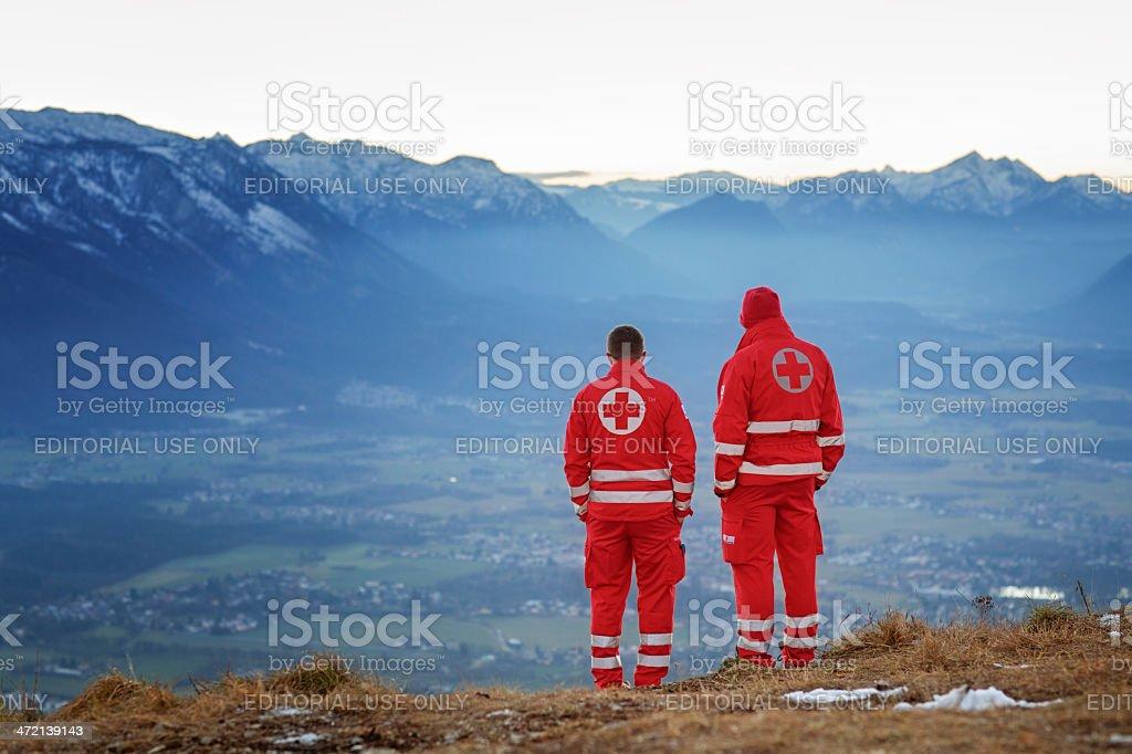 mountain rescue - red Cross helper in mountain stock photo