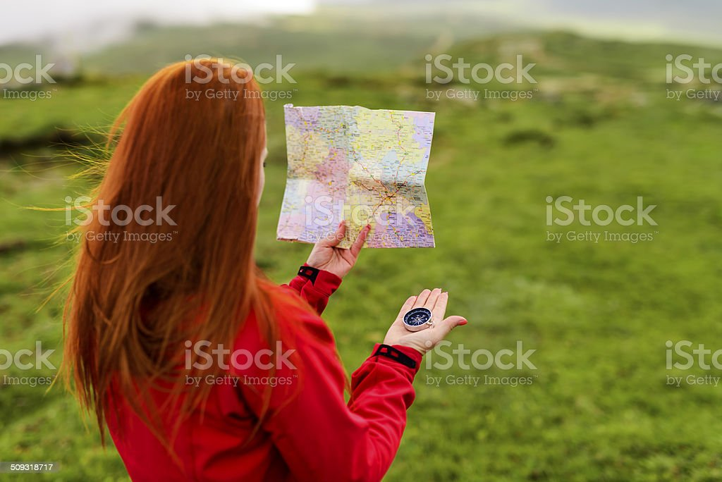 mountain ride with map stock photo