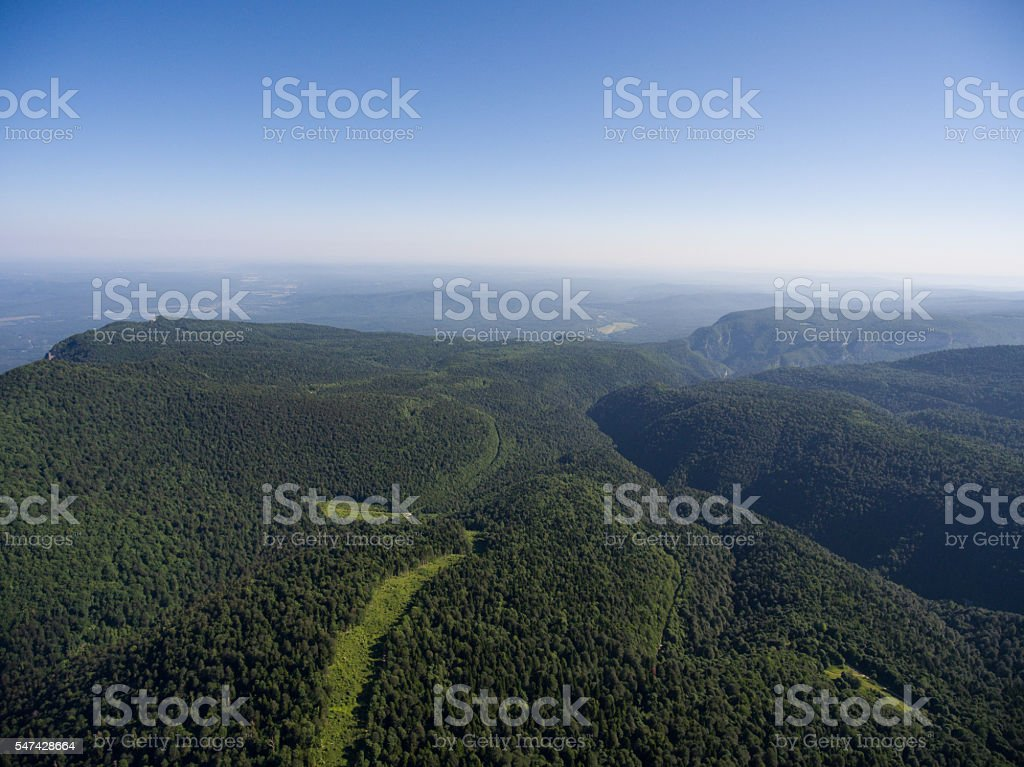 Mountain ridge covered forest. Road in the forest. Mountain landscape. stock photo