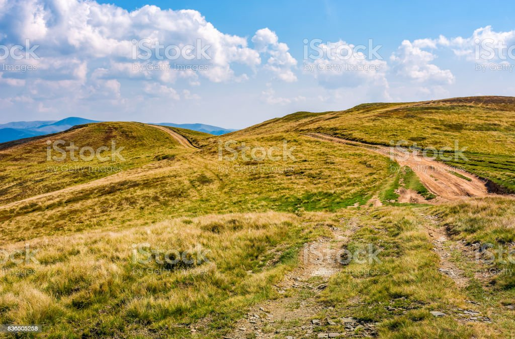 mountain ridge dirt road  under the clouds stock photo