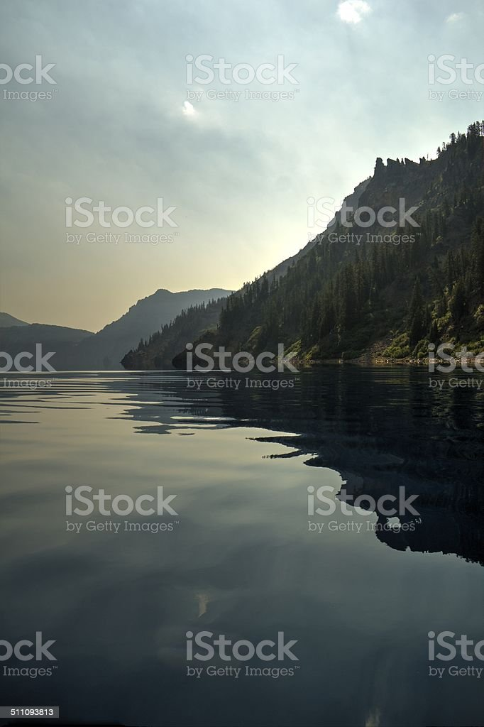 Mountain rising from lakeside stock photo