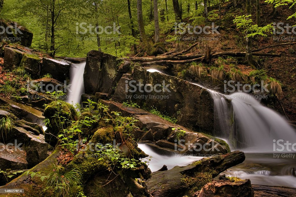 mountain river in the forest of mountains with a waterfall royalty-free stock photo