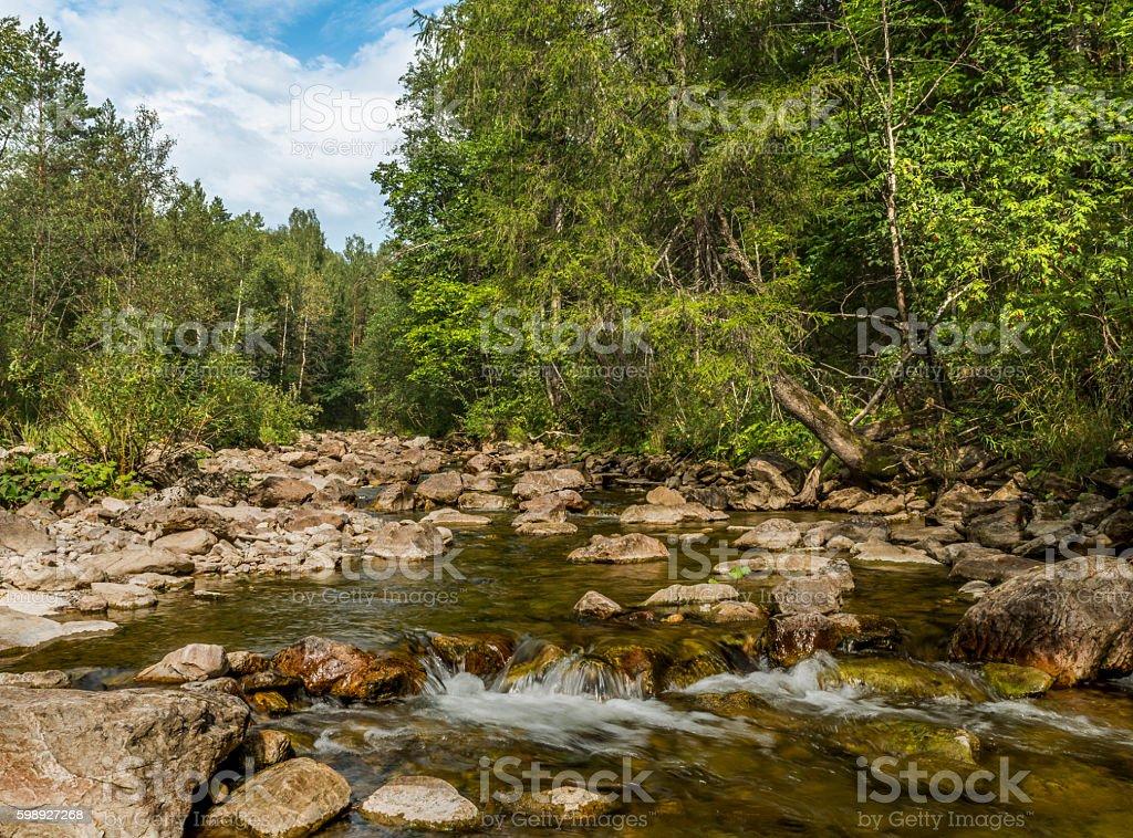 Mountain river in Ural mountains. stock photo
