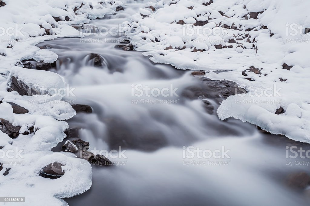 mountain river in winter time stock photo