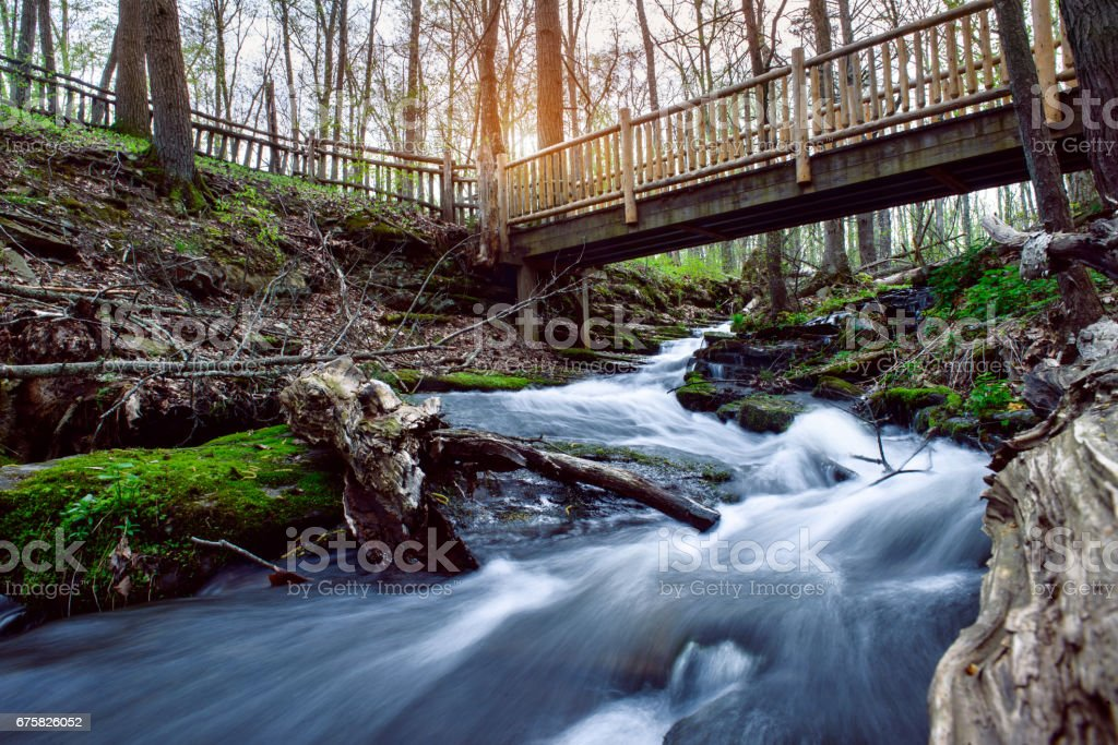 Mountain river with hiking bridge for tourist people hiking stock photo