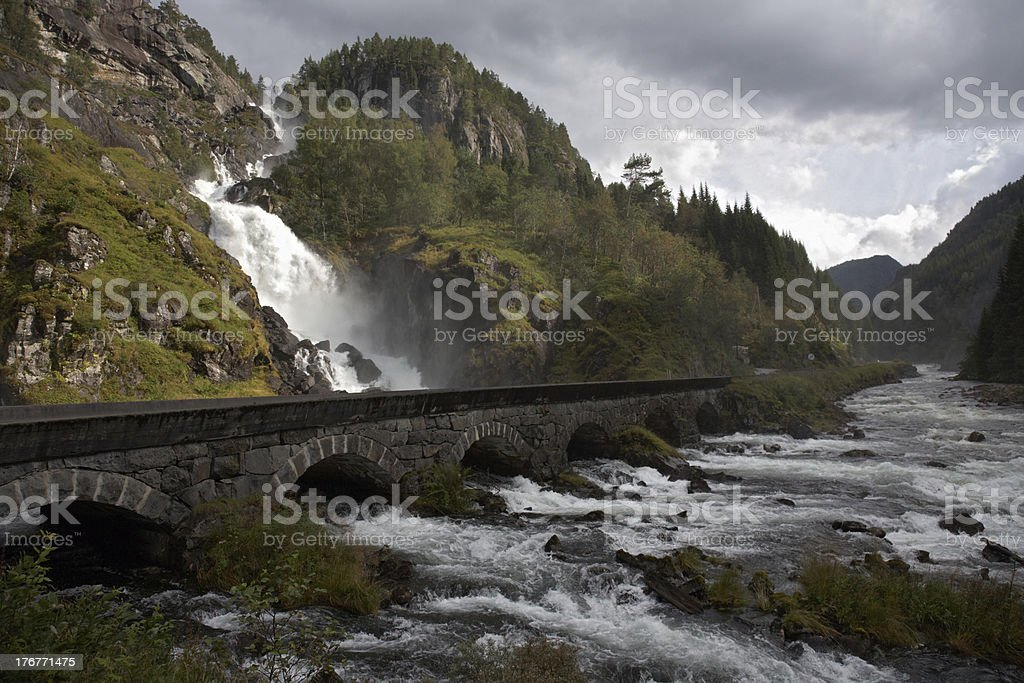 Mountain road and waterfall stock photo