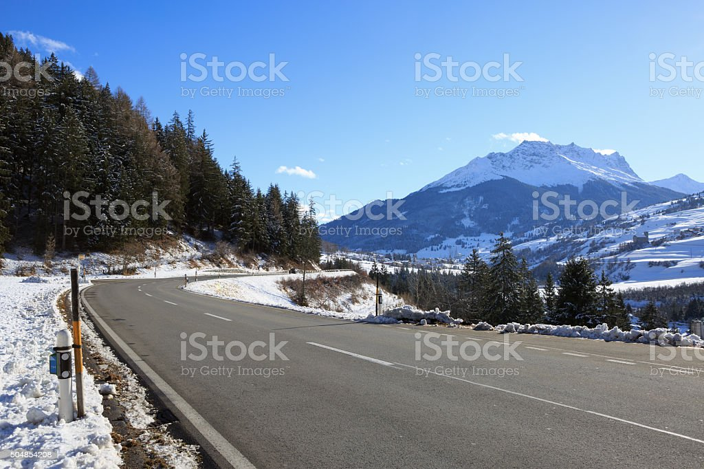 Mountain road in a sunny day (Swiss alps). stock photo