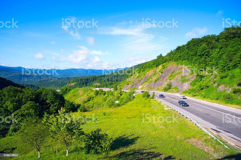 Mountain road in Goryachy Klyuch pass of  main Caucasus ridge. stock photo