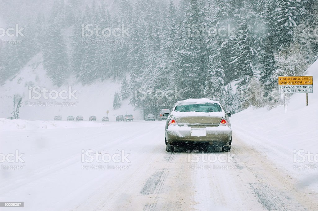 Mountain road in snow storm royalty-free stock photo