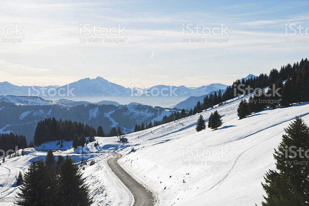mountain road near Avoriaz town in Alps stock photo