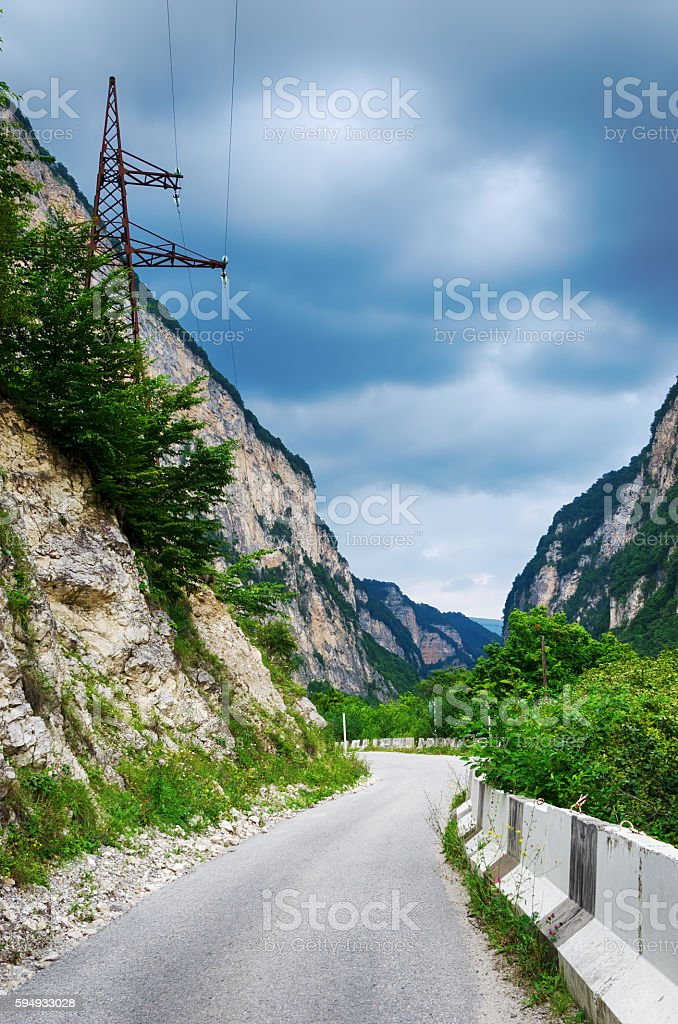 Mountain road on a cloudy day stock photo