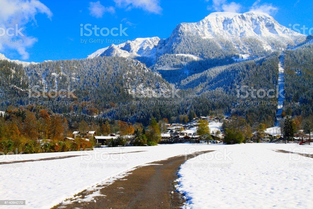 Mountain Road pass to Alpine village in Waxenstein Bavarian Alps, idyllic Pine trees woodland under snow landscape, majestic alps valley, dramatic Bavaria german Snowcapped mountain range panorama, Berchtesgaden alps, Germany stock photo