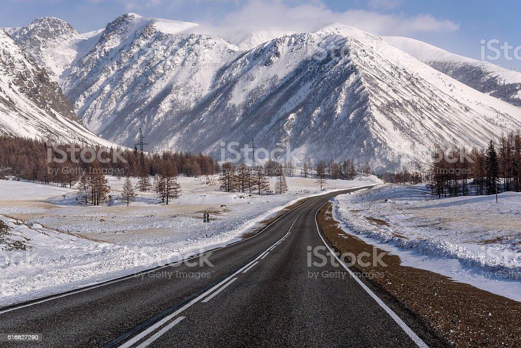 mountain road snow winter trees stock photo