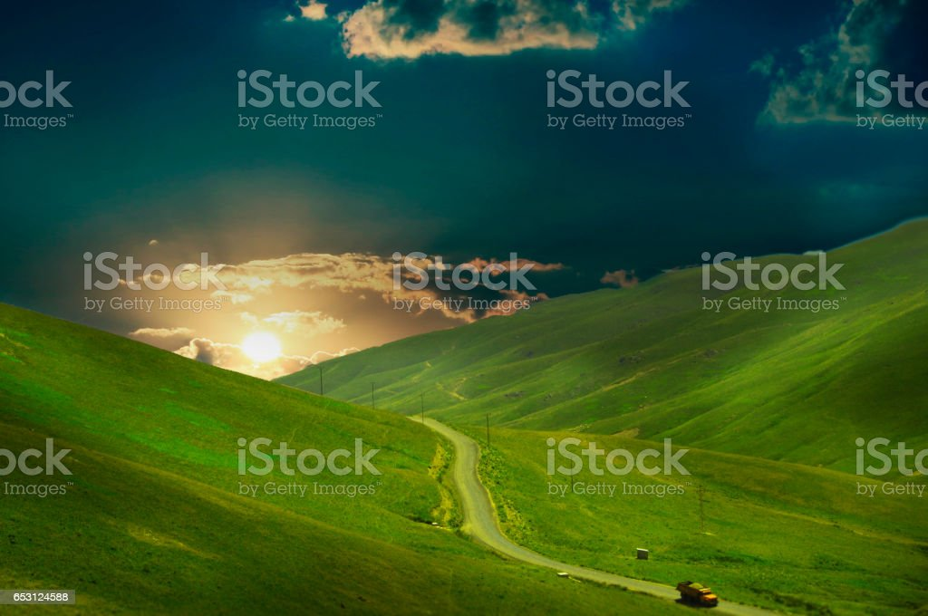 Mountain, road, sunset stock photo