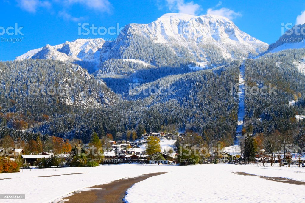 Mountain road to Alpine village in Waxenstein Bavarian Alps, idyllic Pine trees woodland under snow landscape, majestic alps valley, dramatic Bavaria german Snowcapped mountain range panorama, Berchtesgaden alps, Germany stock photo