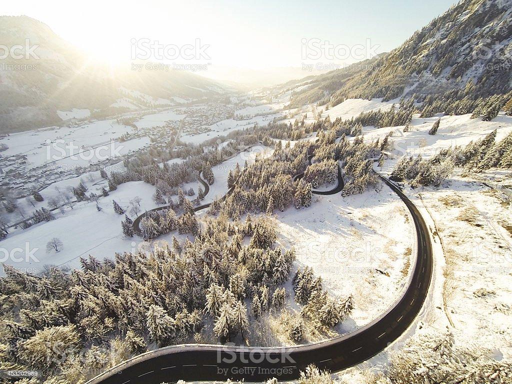 mountain road winding through the german alps stock photo