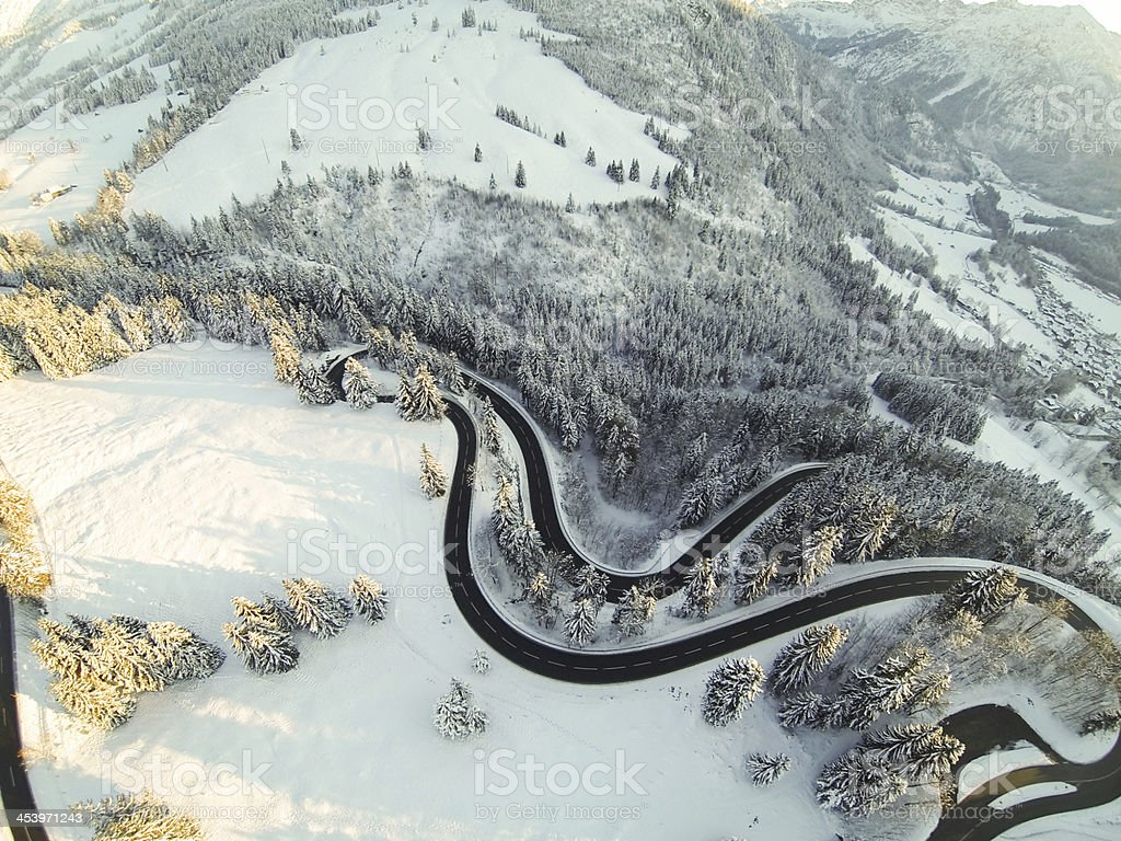 mountain road winding through the german alps stock photo