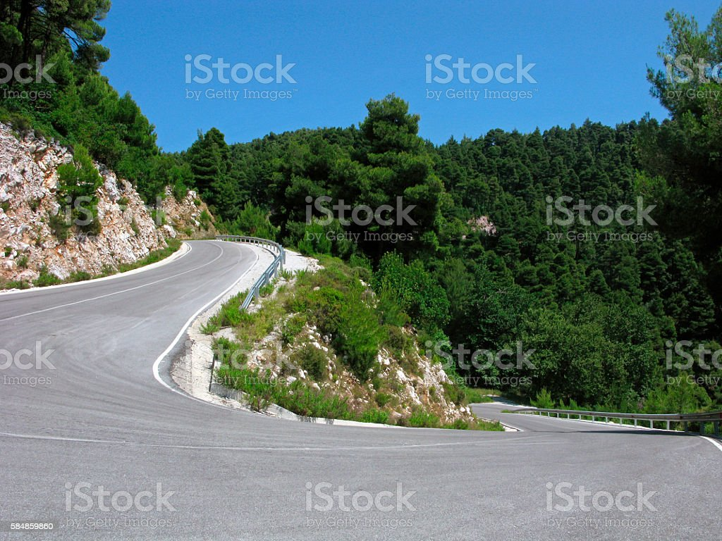 Mountain road with sharp turn stock photo