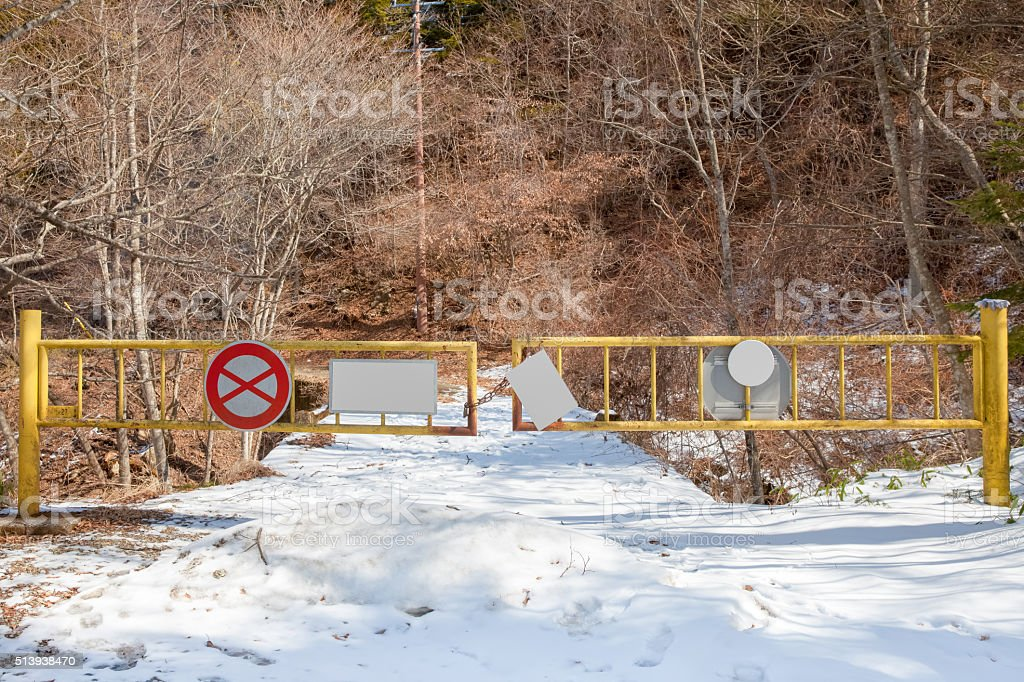 Mountain road with snow closed in winter season stock photo